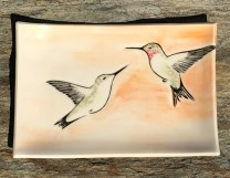 Stoneware platter, sgraffito carved hummingbirds motif